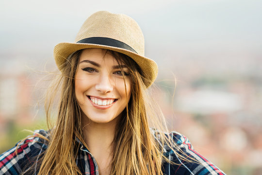 Beautiful young blonde woman in autumn smiling