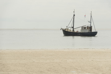 Fishing boat nearby the beach .