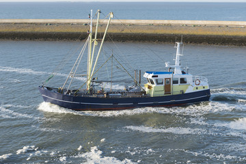 Fishing boat entering a Dutch fishing port.