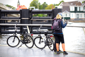 Cyclists consult a map in Zaandam, Netherlands
