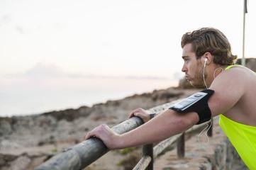 Spain, Mallorca, Jogger at the beach,  listening music