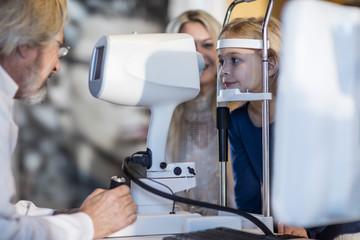 Girl doing eye test at optometrist's