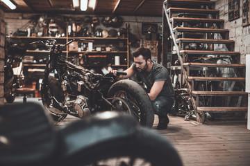 Man repairing bike.