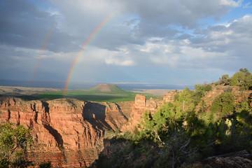 Beautiful double rainbow after thunderstorm at sunset. Grand Canyon National Park, Arizona, USA.