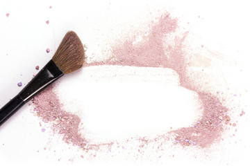 Makeup brush on white background, with traces of powder