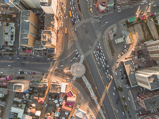 Overhead view of traffic at crossroad in city during sunset