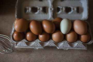 Eggs in egg carton on table