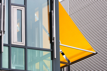Modern office building with yellow awnings