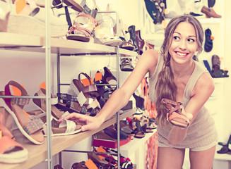 Woman choosing pair of summer shoes