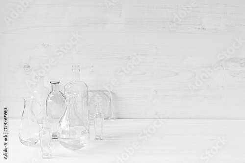 Empty Transparent Bottles On A White Wood Background Home Decor