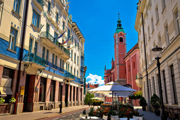 Aluminium Prints Eastern Europe Ljubljana street view with cafe and church
