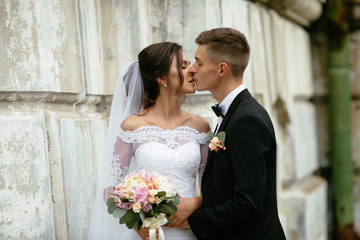 Happy bride and groom kissing at their wedding day.