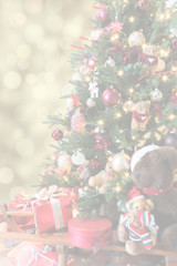 Blurred Christmas background. Christmas tree with decoration, gifts and bears. Greeting card concept with copy space.