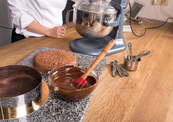 chocolate cake baking ingredients on kitchen table with kitchenware, top view
