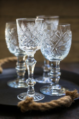 Old crystal glasses and christmas time decoration