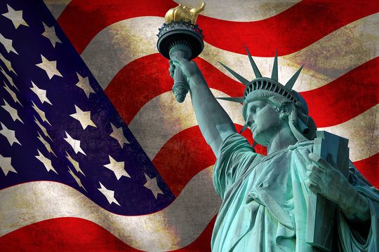 Statue of Liberty with USA flag in the background