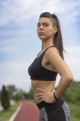 Fitness girl on tartan track
