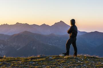 The man admires sunrise.