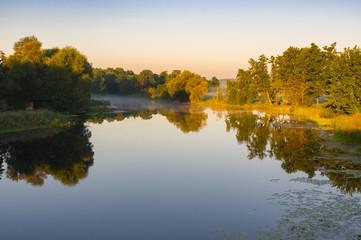 Tranquil landscape on a Vorskla river at summer morning in Ukraine