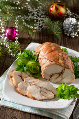 Roll of chicken, baked meat with red wine on the festive Christm