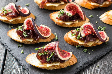 Canape with cheese, onion jam, figs and thyme