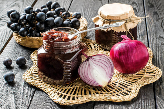 Onion jam with grapes in glass jars