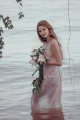 Pretty girl in wet dress.
