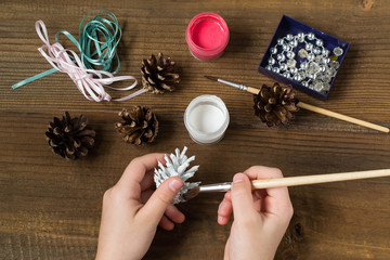Making Christmas decorations from pine cones. Step 2