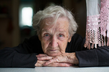 Closeup portrait of elderly woman looking at the camera.