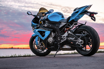 Sports motorcycle on the shore at sunset