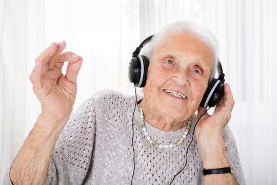 Senior Woman Enjoying Music With Headphone