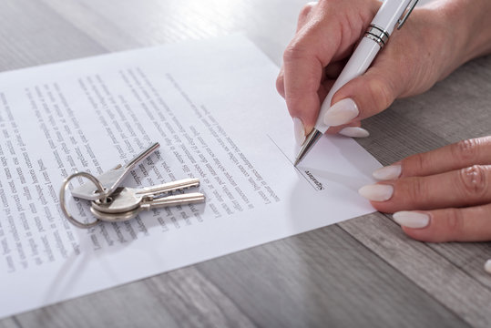 Customer signing a real estate contract