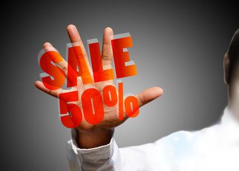 Concept of discount. Hands holding sales.