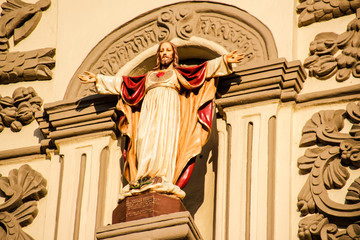 Old church facade with Jesus Sacred Heart statue