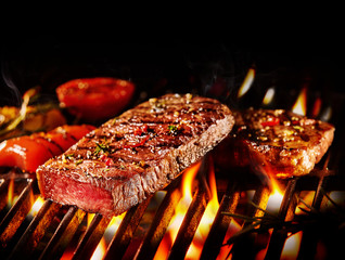Medium rare beef slice on fiery grill