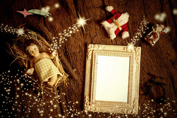 Top view of empty photo frame and Christmas decorations.