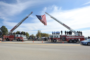 American Flag flown in honor of Officer Blake Snyder Funeral Procession