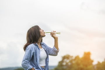 young beautiful woman drinking water