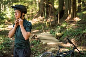 Male athletic wearing bicycle helmet