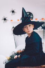 Girl in Witch costume contemplating