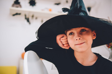 Girl in Witch costume smiling and contemplating