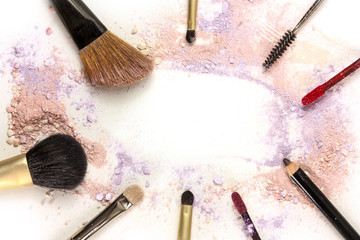 Makeup brushes, lip gloss and pencil with powder