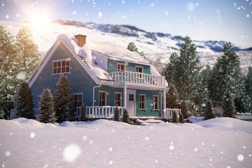Composite image of snow covered house with trees