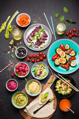 Colorful vegetarian feast dinner table from above