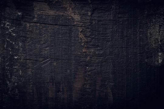 black dark wood background, wooden board rough grain surface