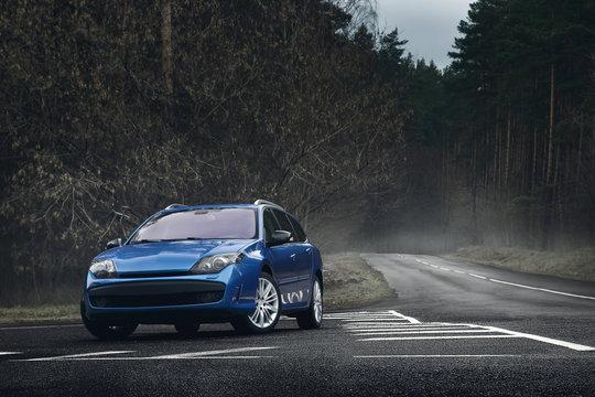 Blue car standing on asphalt road at daytime