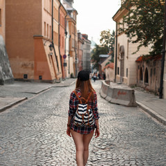 Woman with a backpack walking around the city. Euro-trip.