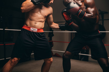 Close up of boxer taking hit in stomach