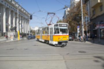 Defocused shot of tram and road traffic