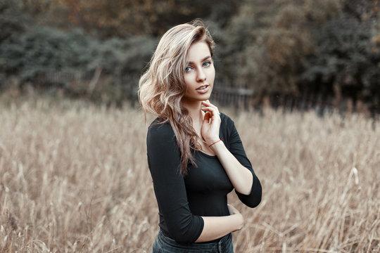 Pretty woman in a black shirt in the corn field